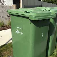 Bin with green lid