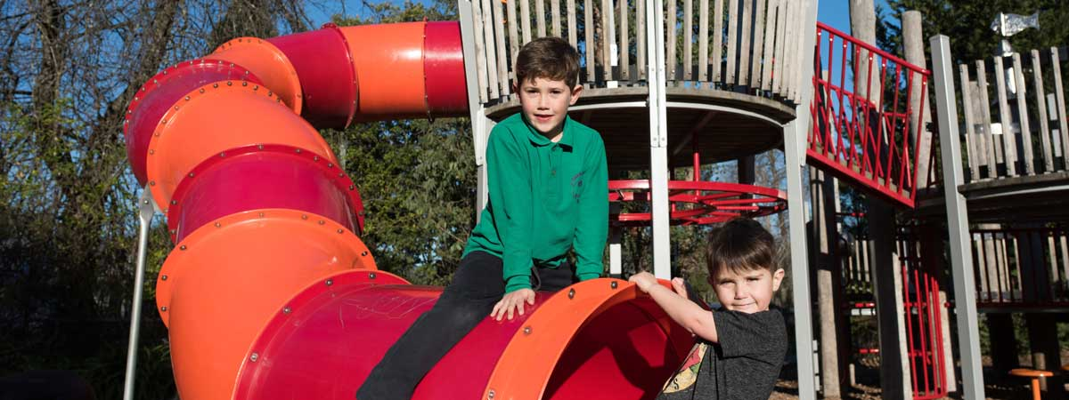 Wyreena Playspace with two boys on slide