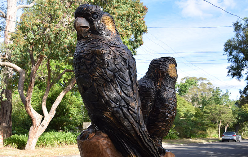 Yellow Tailed Black Cockatoos, Rob Bast, carved acacia stump, 2018