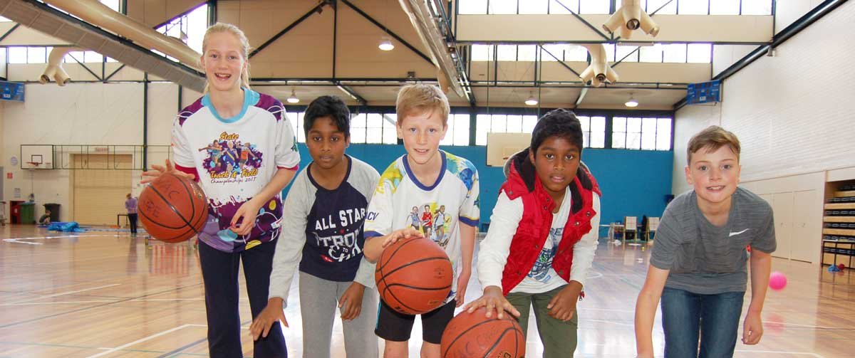 Children with basketballs