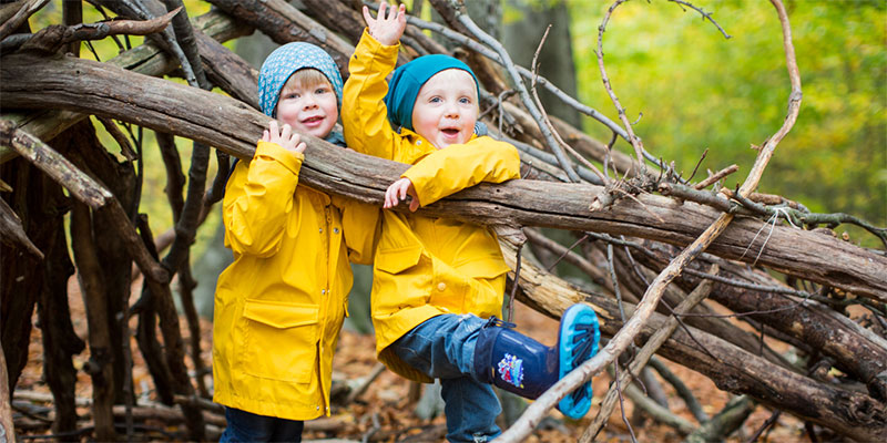 two young kids on branch